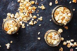 Caramel sweet popcorn in glass jars