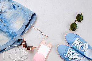 Sneakers, shorts, sunglasses, phone