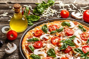 Fresh pizza with tomatoes, cheese an