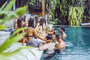 company of friends in the pool