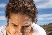 Tired runner girl sweating after run