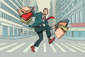 a man with shopping crossing the