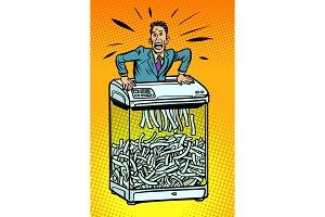 Businessman in paper shredder