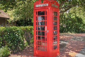 Classical red telephone booth in Eng