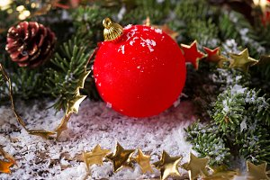 Red Christmas bauble with snow and c