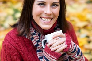 Young smiling woman with cup of tea