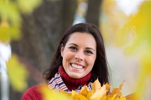 Young smiling woman with colourful m