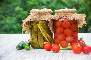 Preserved house tomatoes and cucumbe