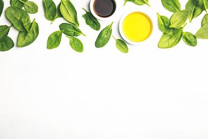 Olive oil, vinegar and fresh spinach
