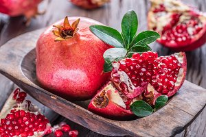 Ripe pomegranate fruits on the woode