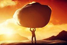 Man lifting a huge rock
