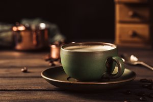 Green cup of coffee with coffee