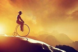 Man on retro bicycle riding downhill