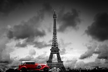 Retro car in front of Eiffel Tower