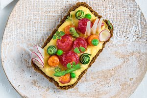 Rye bread topped with omelet and