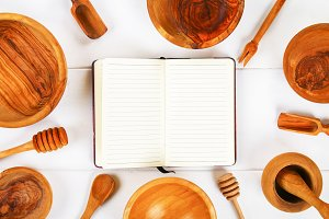 Notebook and wooden utensil in kitch