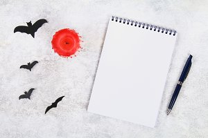 Empty notebook, blood candle, pen an