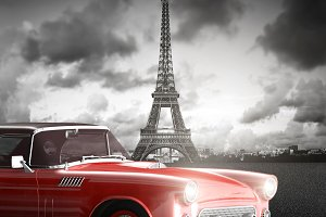 Red car in front of the Eiffel Tower