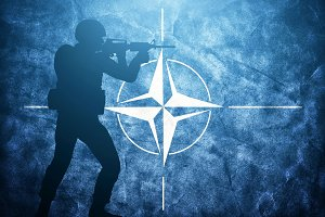 Soldier silhouette on NATO flag