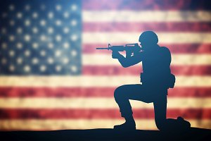 Soldier with weapon on USA flag