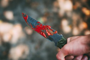 bloody knife in hand