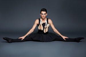 handsome ballet artist in tutu skirt