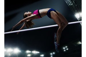 female athlete in action high jump