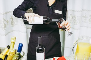 unrecognisable woman serving wine
