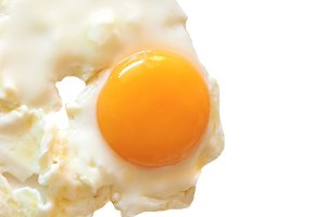 Fried egg isolated over white with c