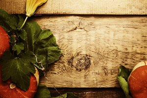 Autumn wooden background with pumpki