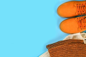 Orange brown mens autumn boots on a