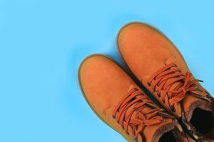 Orange brown mens autumn boots on a