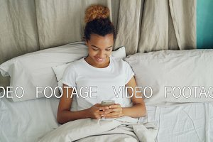 Cheerful African American lady using