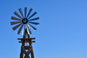 Windmill on an agricultural farm in
