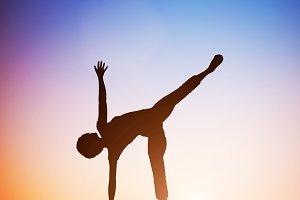 Woman in half moon yoga position