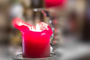 Close-up detail of red candle in sil