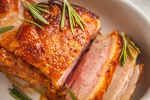 Baked pork with rosemary.