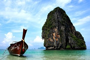 Typical Thai boat and remote island