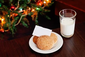 Christmas cookies and milk with note