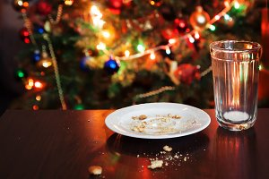 empty glass from milk and crumbs fro