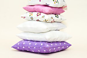 Tower of toy multi-colored pillows