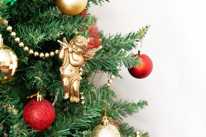 Christmas tree with toys and a golde