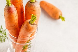 Raw carrots on a white background.