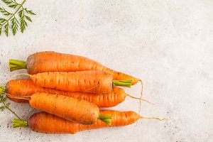 Raw carrots on a white background
