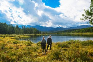 Woman with boy Lake in the Altai