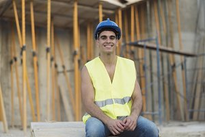 Smiling construction worker having a