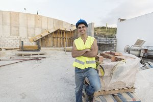 Smiling construction worker posing f