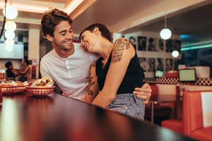 Couple sitting at a diner