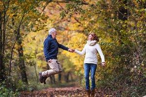 Senior couple in an autumn nature