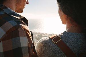Traveler couple admiring seascape